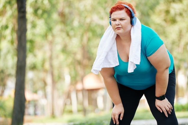 Woman tired after jogging in park