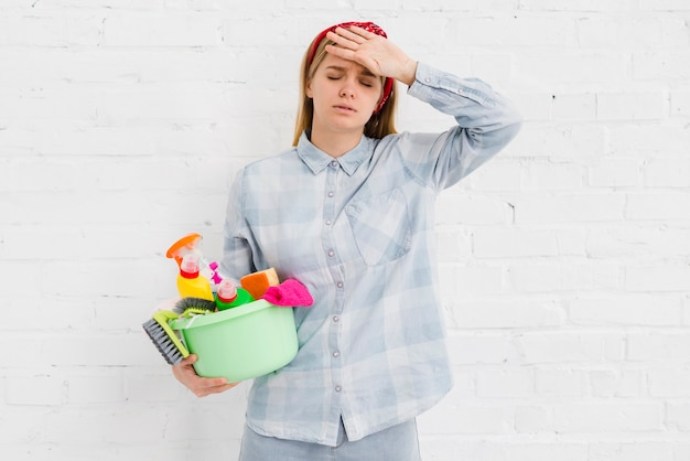 Woman tired of cleaning the house