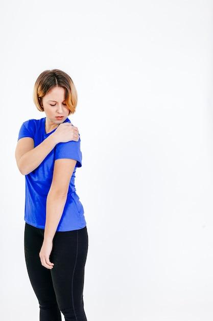 Woman touching aching shoulder