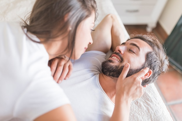 Woman touching beard of boyfriend