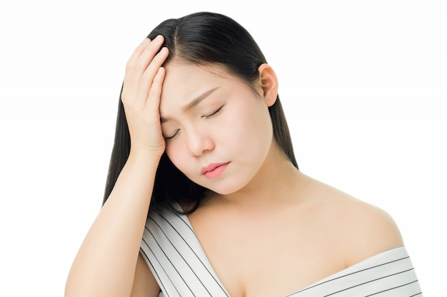 Woman touching head to show her headache. causes may be caused by stress or migraine.