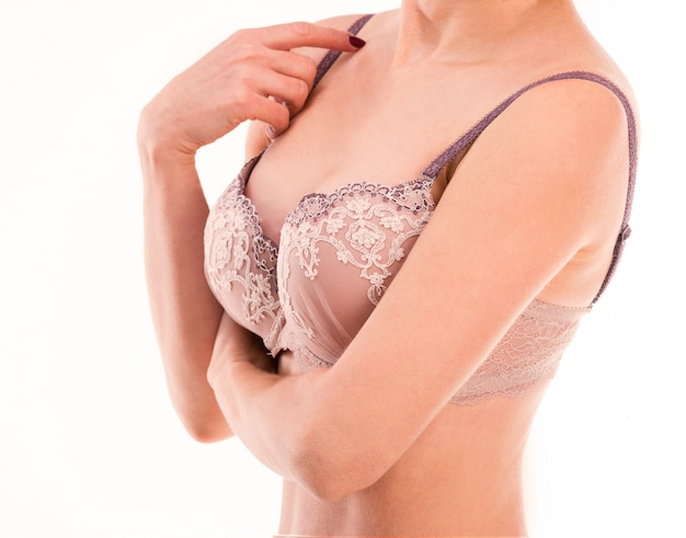 Woman touching her bra strap, isolated