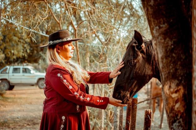 Woman touching horse's mane