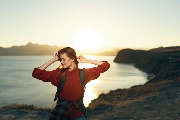 Woman tourist backpack island travel walk landscape