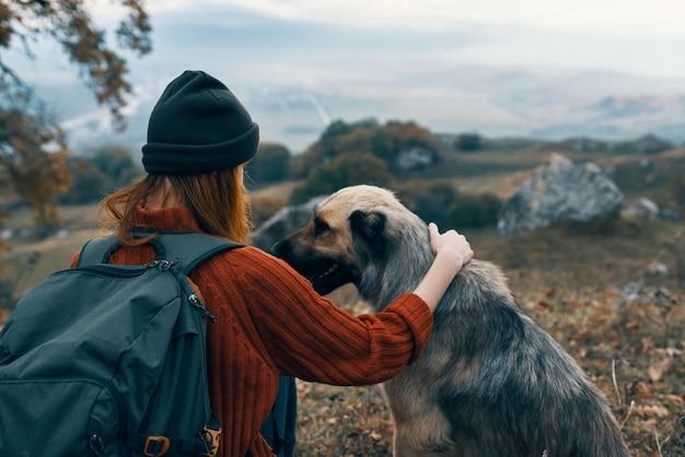 Woman tourist next to dog nature travel landscape