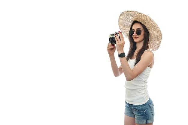 Woman tourist taking photo isolated on white