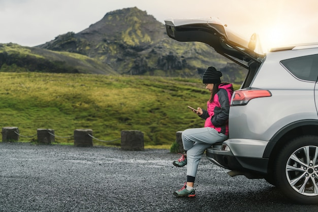 Woman tourist travel by suv car in iceland.
