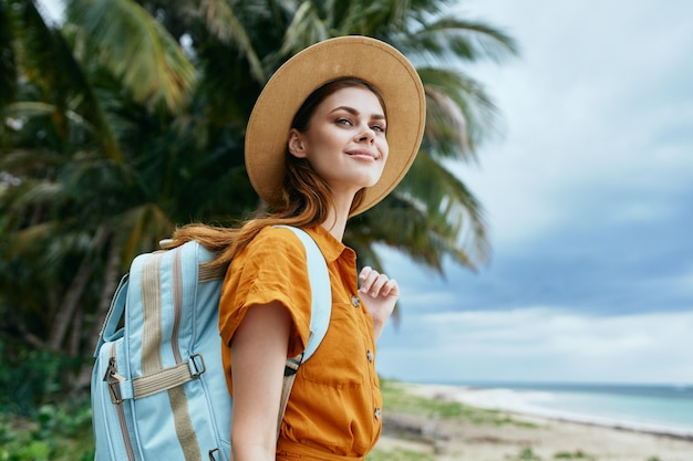 Woman tourist with backpack island travel fresh air nature
