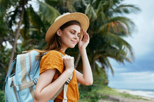 Woman tourist with backpack travel walk island exotic