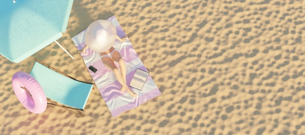 Woman on a towel on the sand of the beach with hammock and parasol