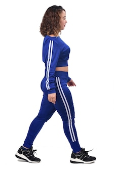 Woman in tracksuit walking isolated