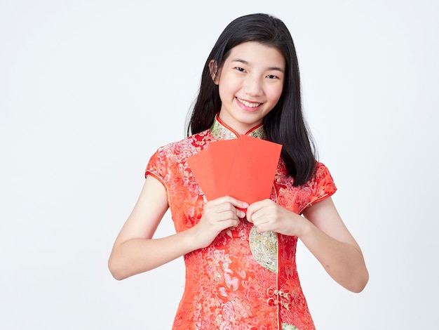 Woman in traditional chinese dress holding red envelope