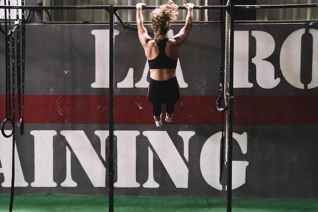 Woman training on bar
