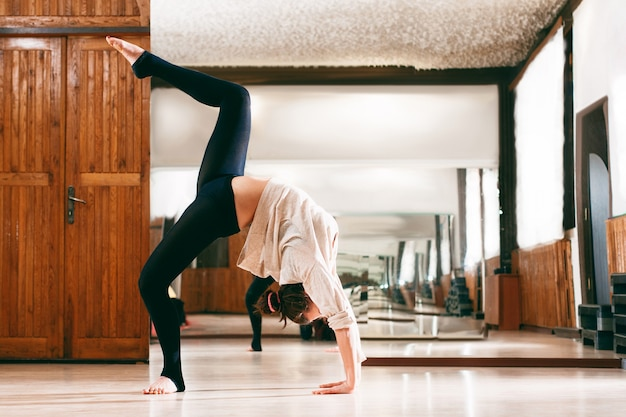 Woman training flexibility in dance studio
