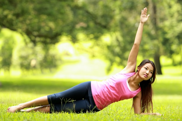 Woman training on grass