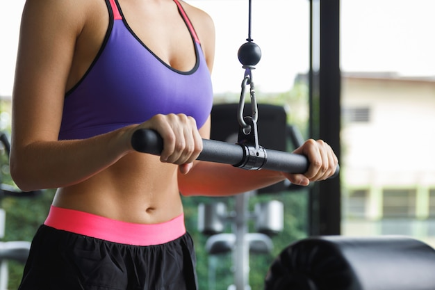 Woman training her triceps in the gym