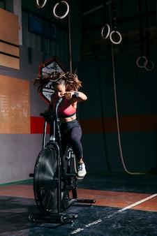 Woman training on stationary bike