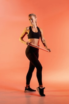 Woman training with elastic band