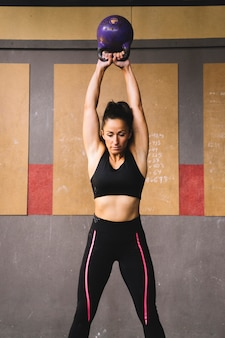 Woman training with kettlebell