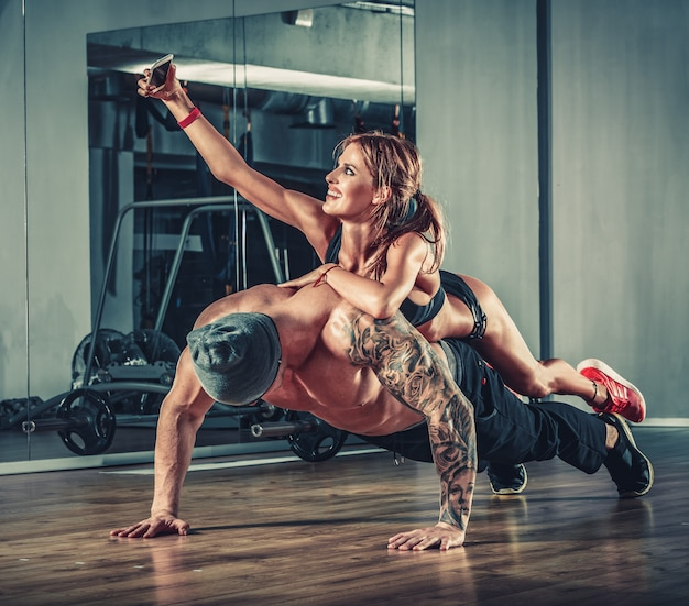 Woman training with man in gym