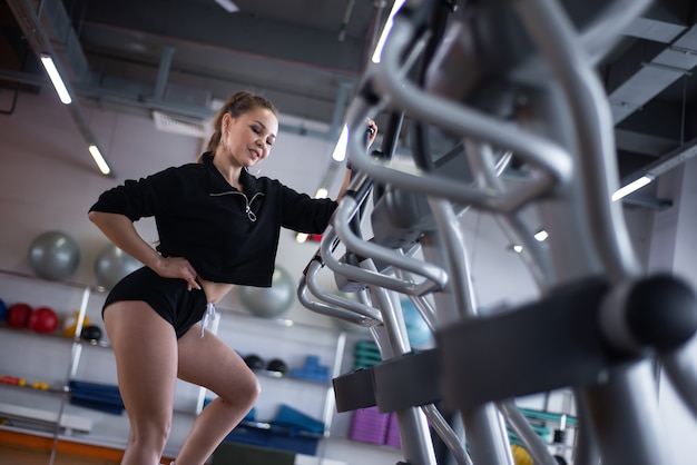 Woman trains on a treadmill in the gym.