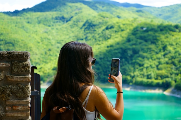 Woman travel and active lifestyle concept using smart phone