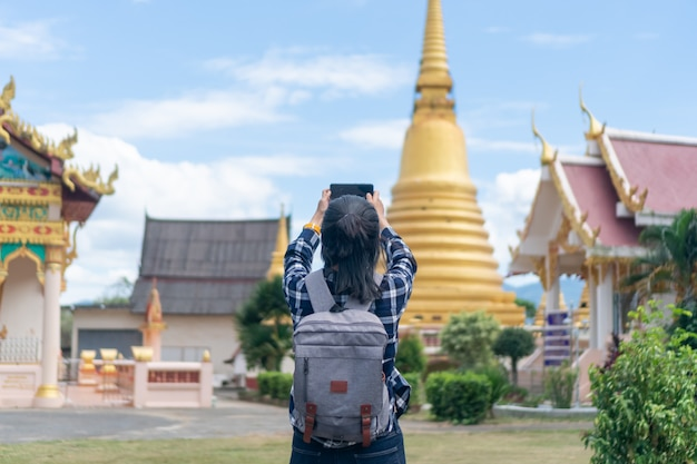 Woman travel around the world with backpack freedom concept.