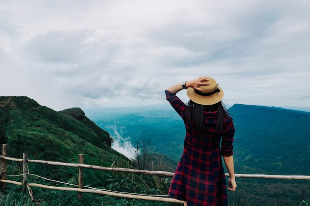 Woman travel rainy season mountain view relax in the holiday