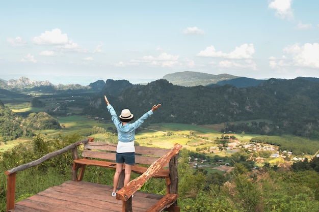 Woman traveler enjoying view and happy freedom at mountains. thailand