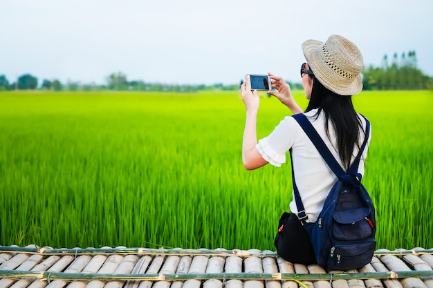 Woman traveler enjoying with green rice field on her holiday.