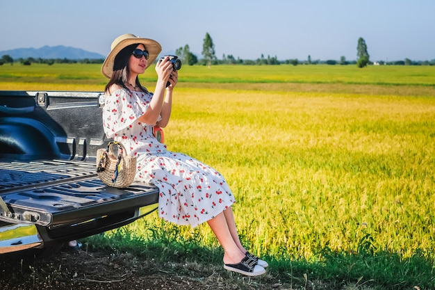 Woman traveler have a relax time during traveling beside the road.