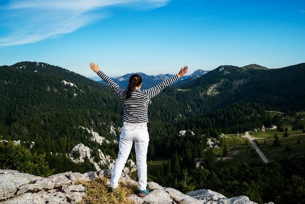 Woman traveler hiking across croatia landscape.