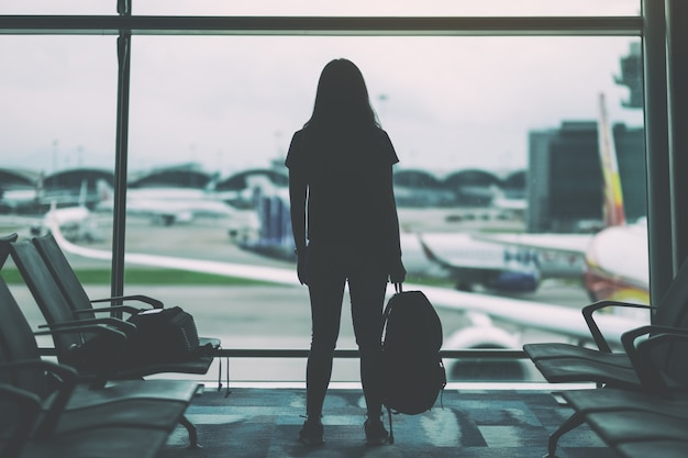 A woman traveler with backpack at the airport