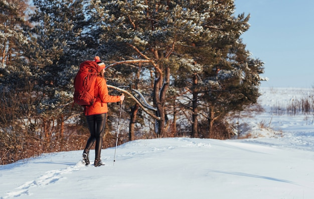 Woman traveler with backpack hiking travel lifestyle adventure  active vacations outdoor. beautiful landscape  forest