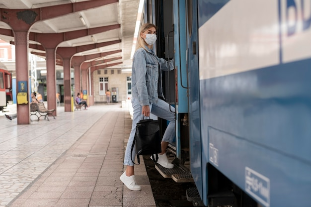 Woman traveling by train wearing medical mask for protection