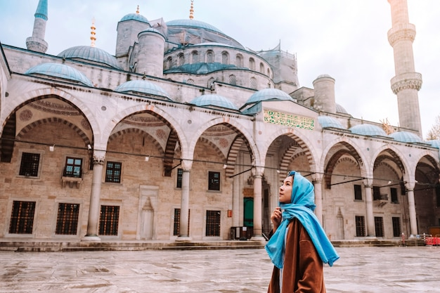 Woman traveling in istanbul blue mosque, turkey