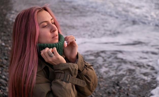 Woman traveling at seaside medium shot