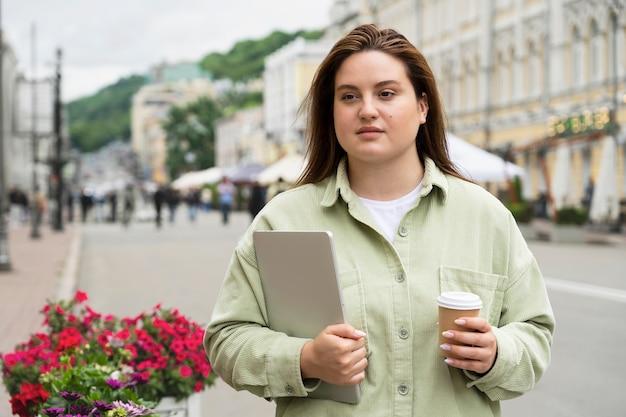 Woman traveling with laptop medium shot