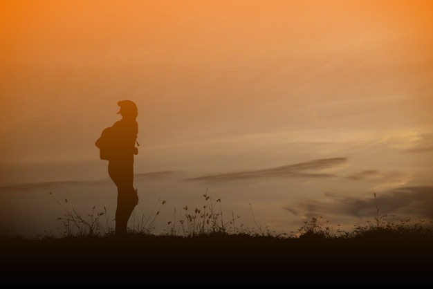 Woman travelling in nature with backpack