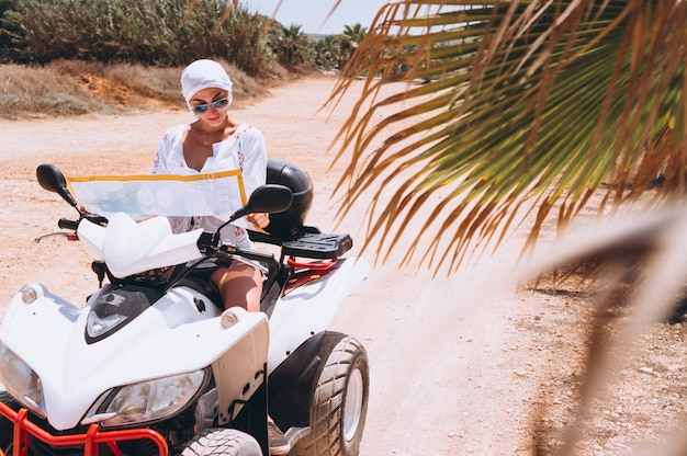 Woman travelling on quad with map