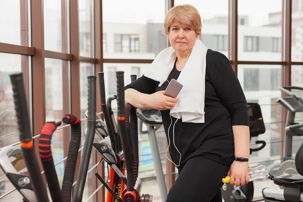 Woman on treadmill listening music