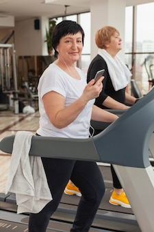 Woman on treadmill with mobile