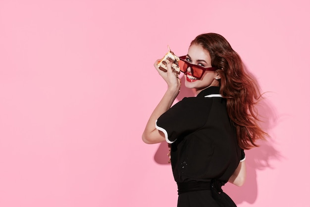 Woman on trendy glasses modern style glamor pink background