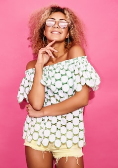 Woman in trendy summer clothes posing