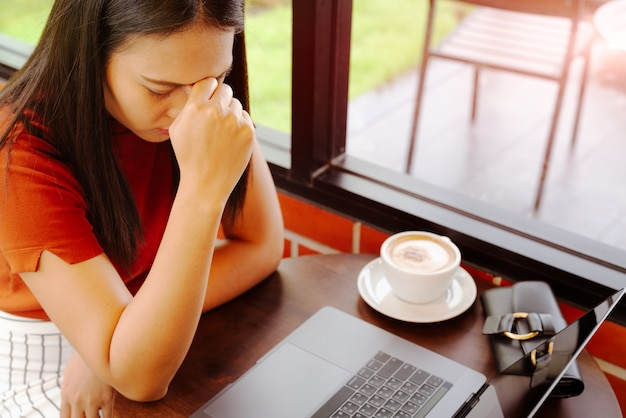 Woman tried after long working on laptop