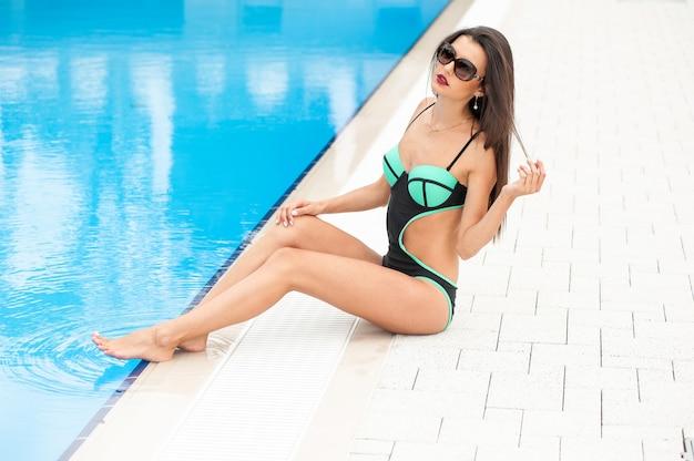 Woman on the tropical resort resting in beachwear