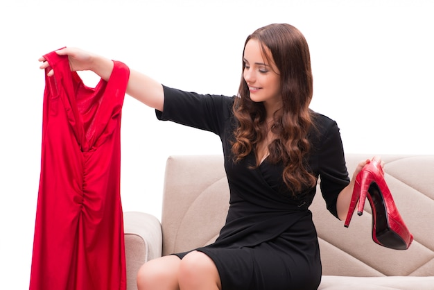Woman trying new clothing sitting on sofa