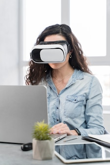 Woman trying a new vr technology in the office
