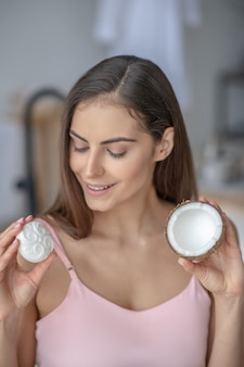 Woman trying a soap with a coconut oil