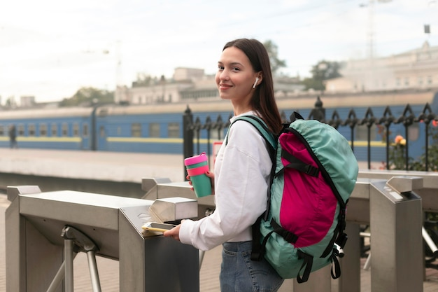 Woman at the turnstiles wearing a backpack